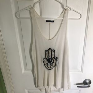 Cream colored tank top with a hamsa
